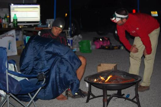 Keeping Dave warm with a roaring cardboard fire (we ran out of firewood) after his finish.