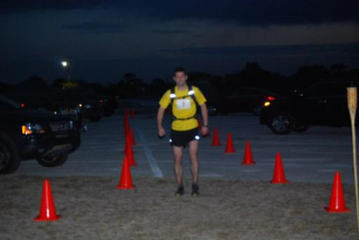 Tim marching across the finish line in 24 hours 30 minutes. Good enough for 5th overall.