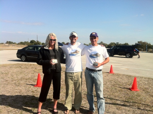The race director with the winners Dave James and Claire Dorotik after presenting them with their champion buckles.